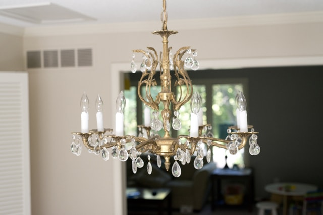 How to Update an Old Chandelier with Yellow Candle Sleeves