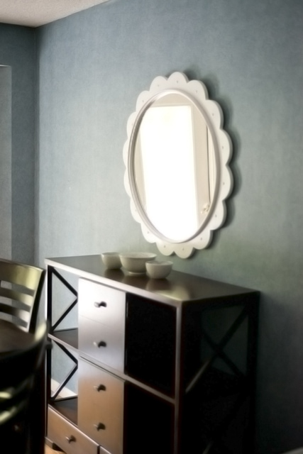 round mirror over console