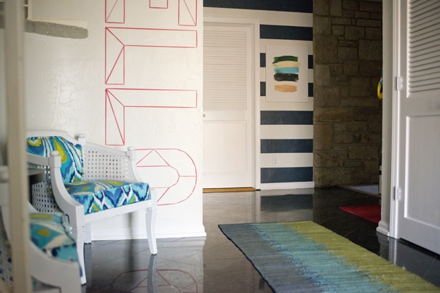 Bold and Bright Entryway with painted stripes on a textured wall
