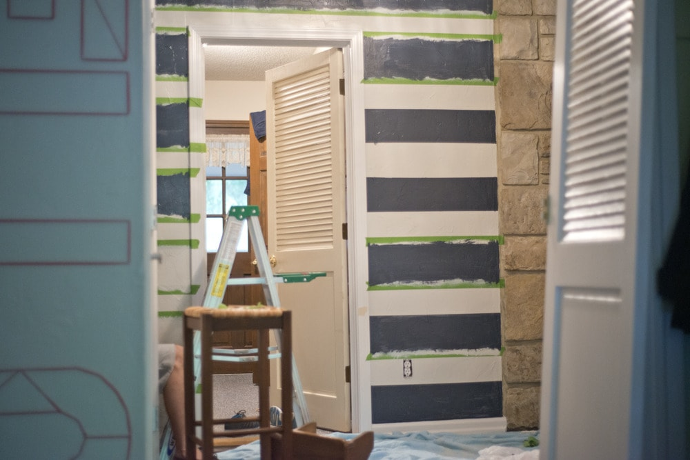 Painting_navy_stripes_in_entryway