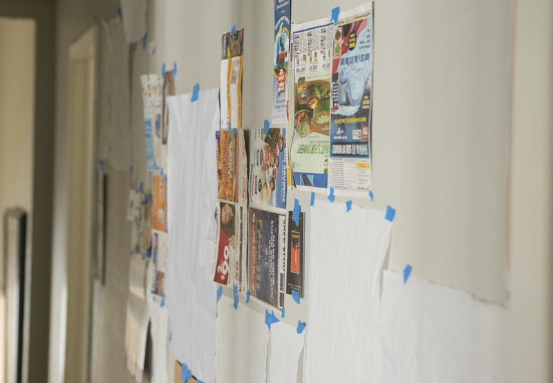 gallery wall with newspaper holders