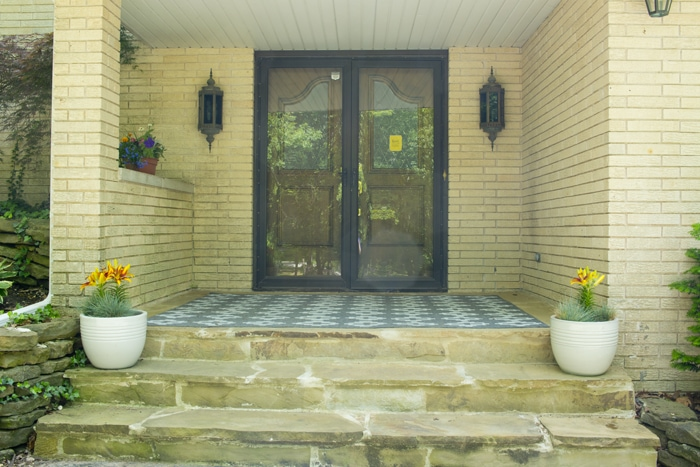 Yellow brick and double front doors picture of the porch
