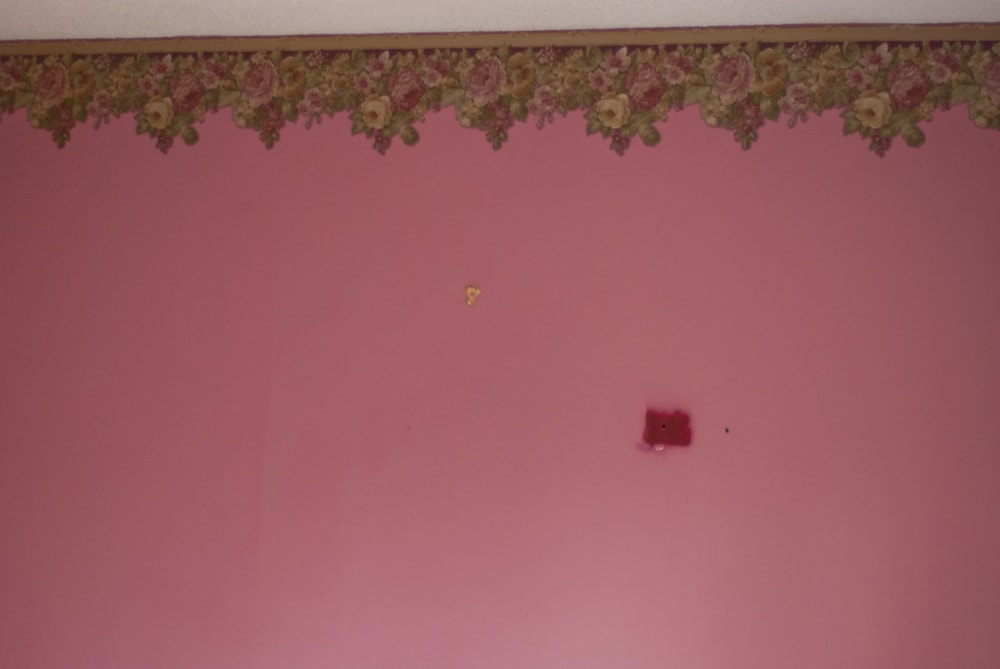 Pink walls and wallpaper before