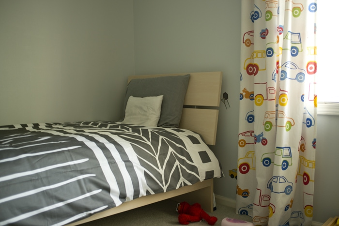 modern bed and quilt for big boy room