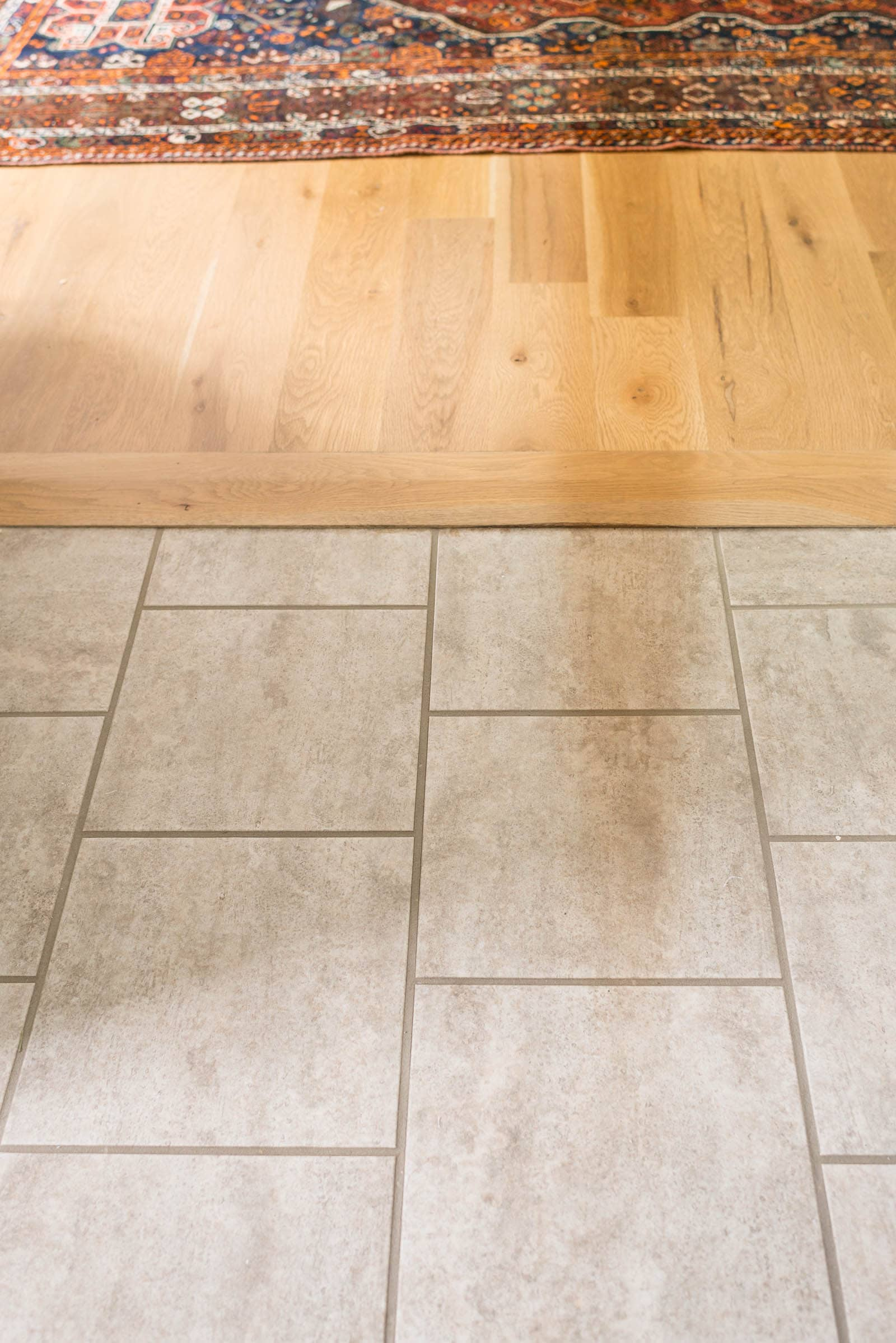 Peel and stick vinyl floor tile transition