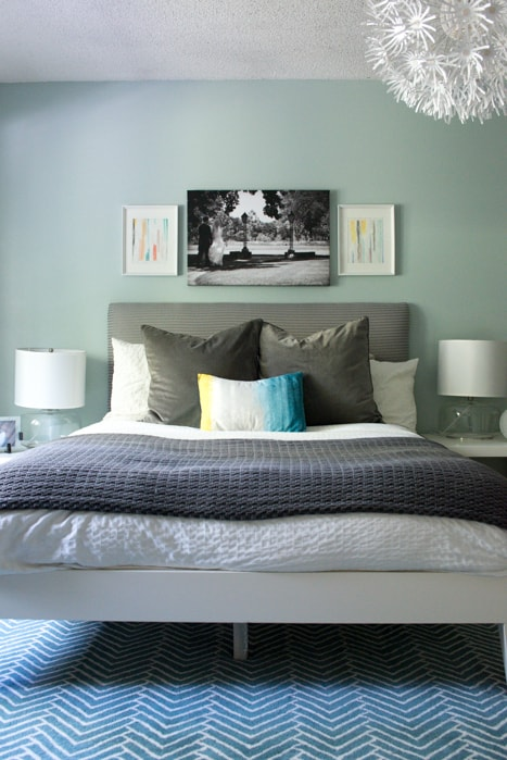aqua and grey master bedroom with frames