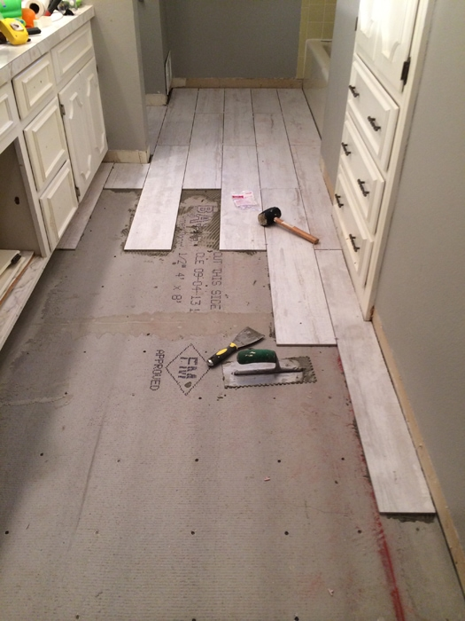 Laying The Whitewashed Wood Grain Tile In Bathroom