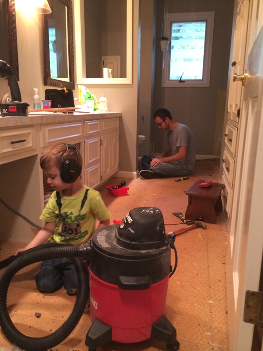 putting the toddler to work vacuuming