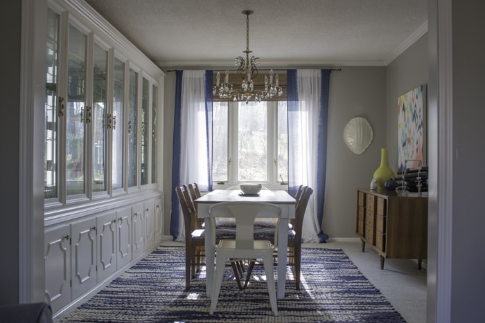formal dining room with bright blue and white colors