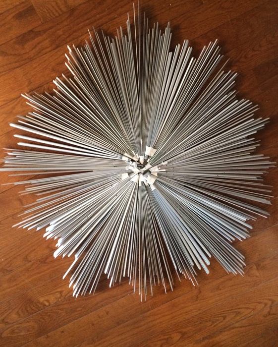 using blinds as pieces of an upcycled mirror