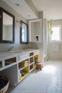 White washed wood tile in hallway bathroom