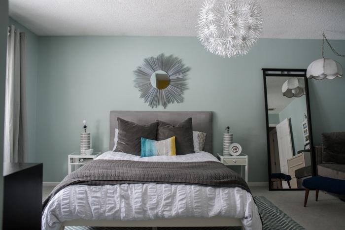 upcycled sunburst mirror in master bedroom