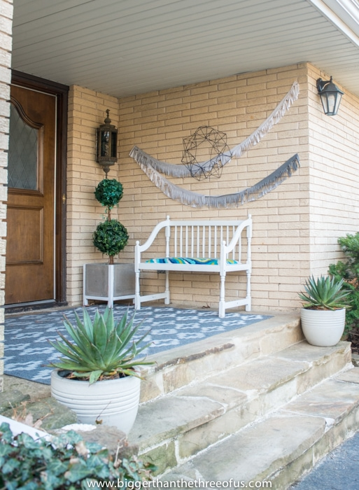 Front Porch with bunting and DIY wreath and rug