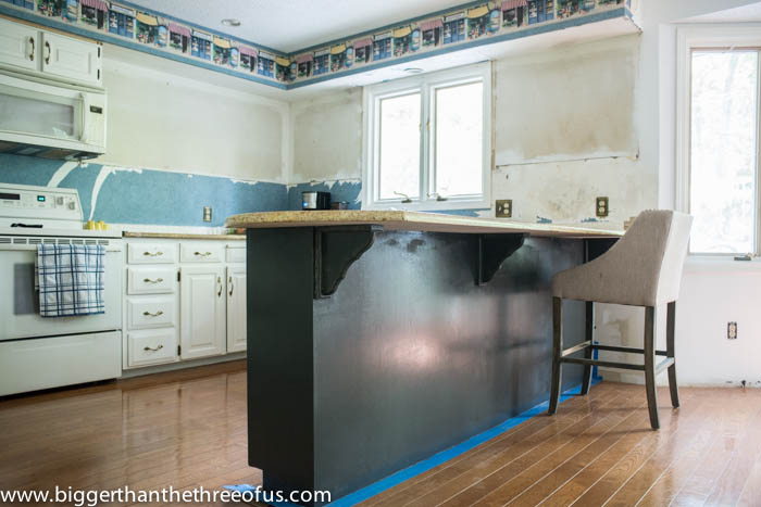Dark painted lower cabinets by Bigger Than The Three Of Us