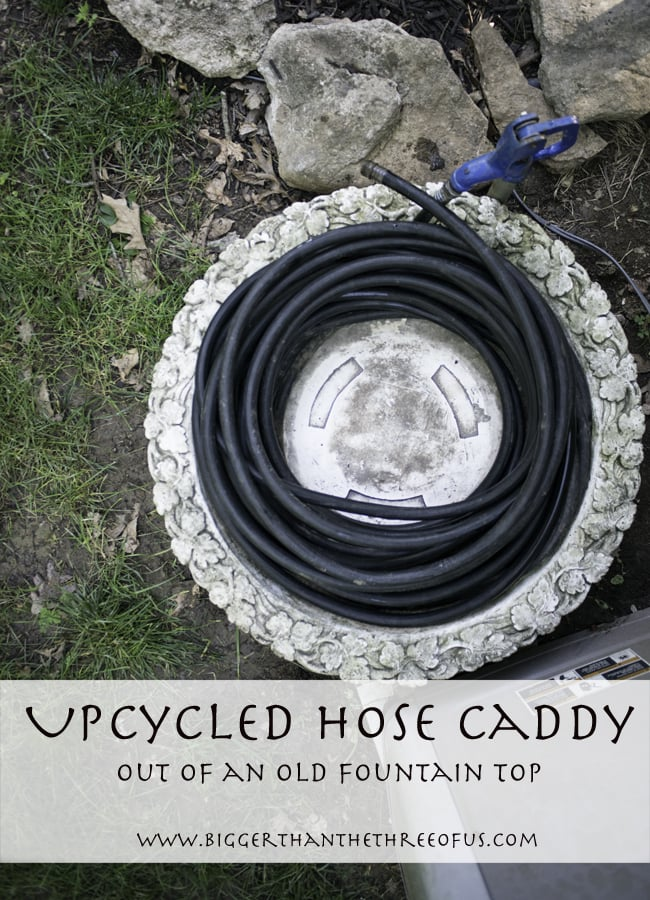 make a hose caddy out of an old fountain top