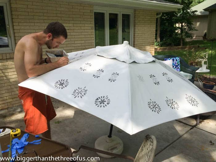 Finishing up the stencil painting on the patio umbrella by Bigger Than The Three Of Us