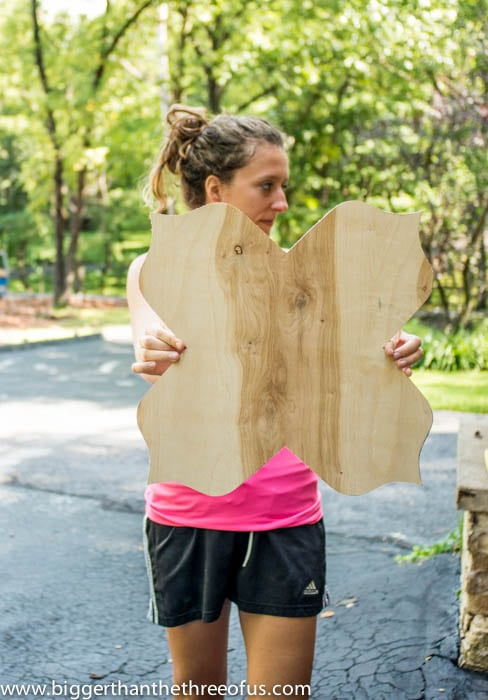 Use a jigsaw to cut the mirror out of plywood