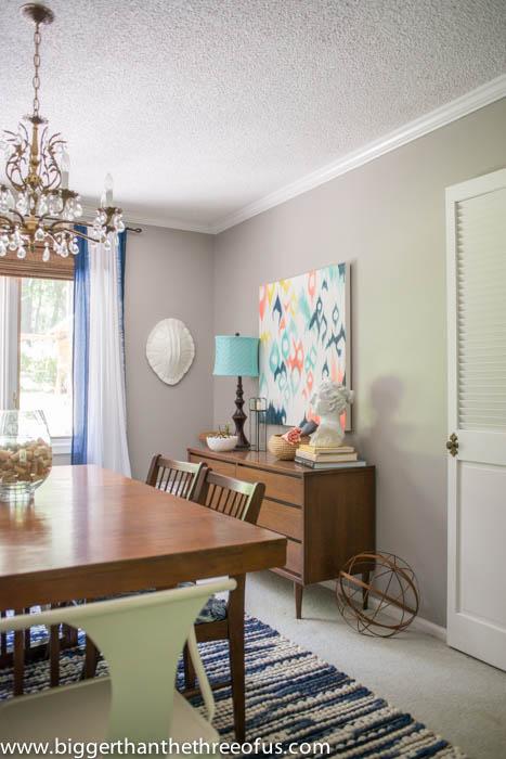 Ikat Artwork and Mid Century Dresser in Formal Dining Room