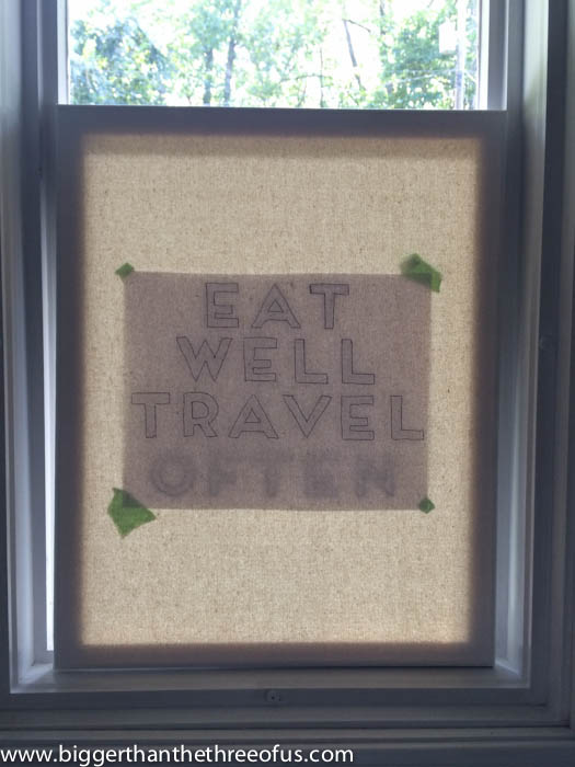 Use a window to trace letters for canvas art