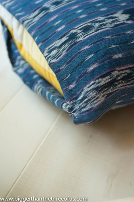 Hand-stich the seam closed for your upcycled DIY pillow