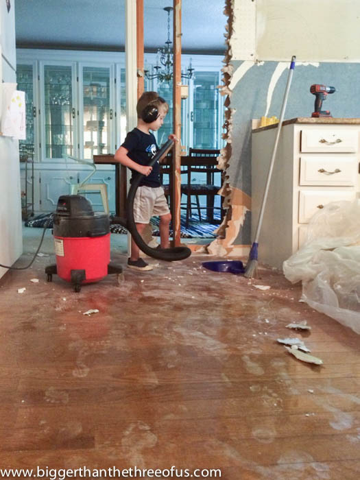 Toddler cleanup for DIY wall removal