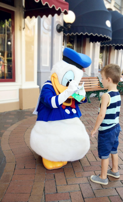 Signing autograph at Disneyland