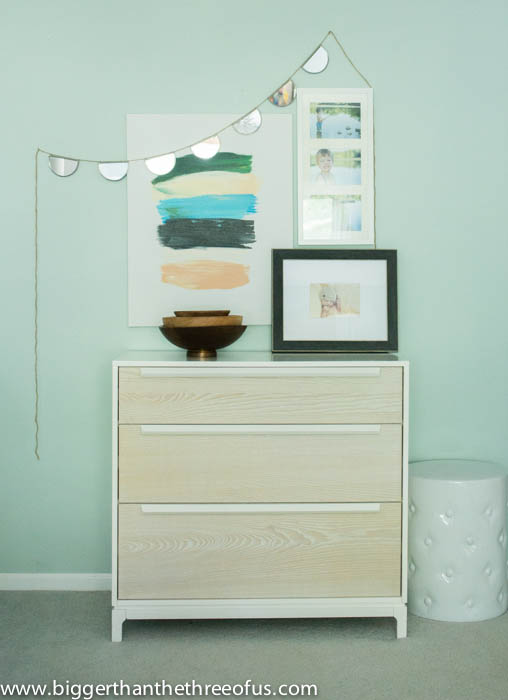 Bedroom dresser styling with wood pieces