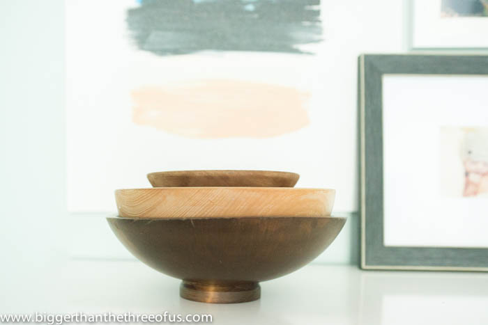 Wooden bowls to add texture and warmth in bedroom