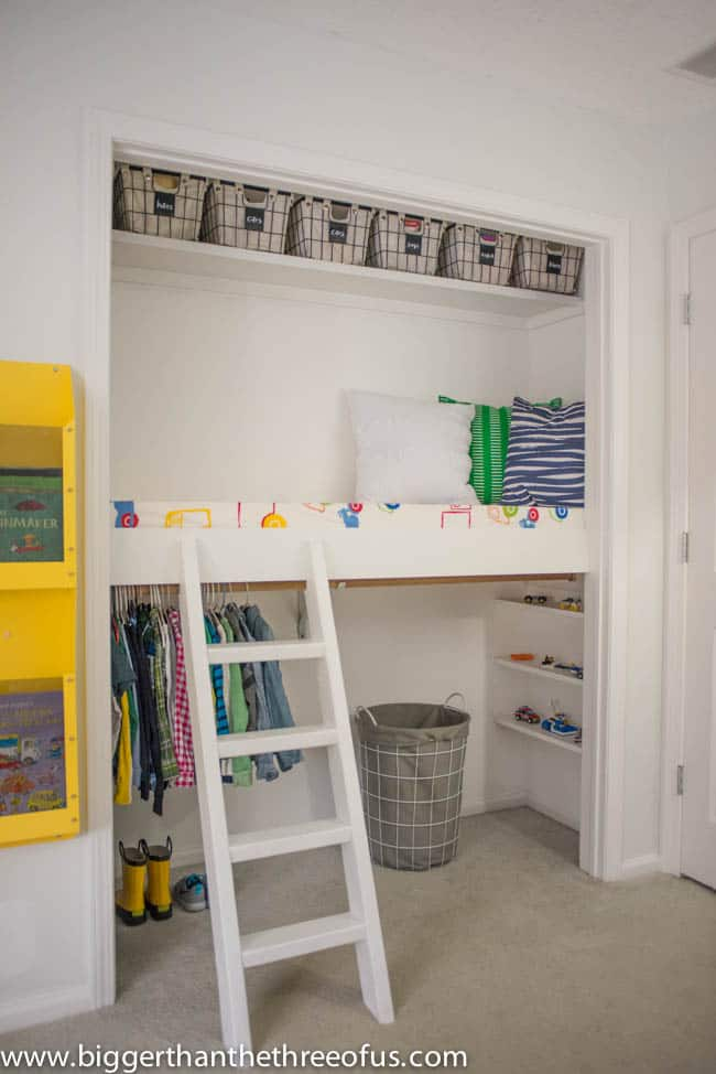 Bright Kids Closet with reading Space in Loft by Bigger Than The Three Of Us