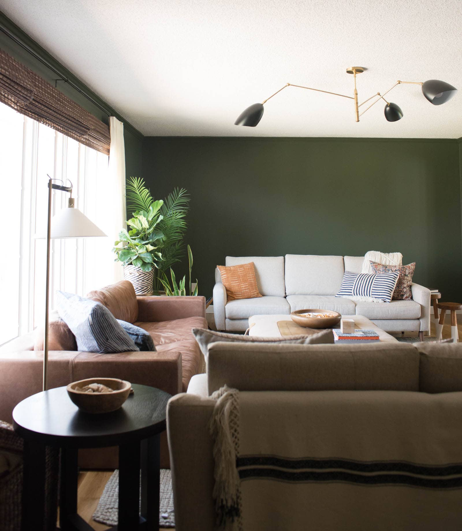 Green living room with bamboo shades