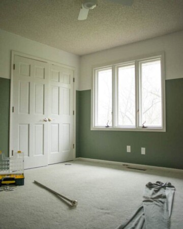 Half painted moody and bright guest bedroom
