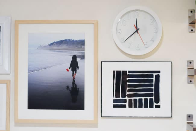 Add a black and white element in your gallery wall