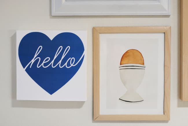 Add a mix of high and lows in your gallery wall
