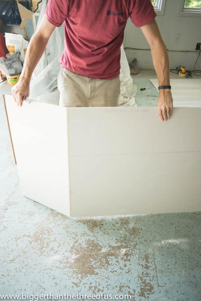 showing how to break sheetrock to install