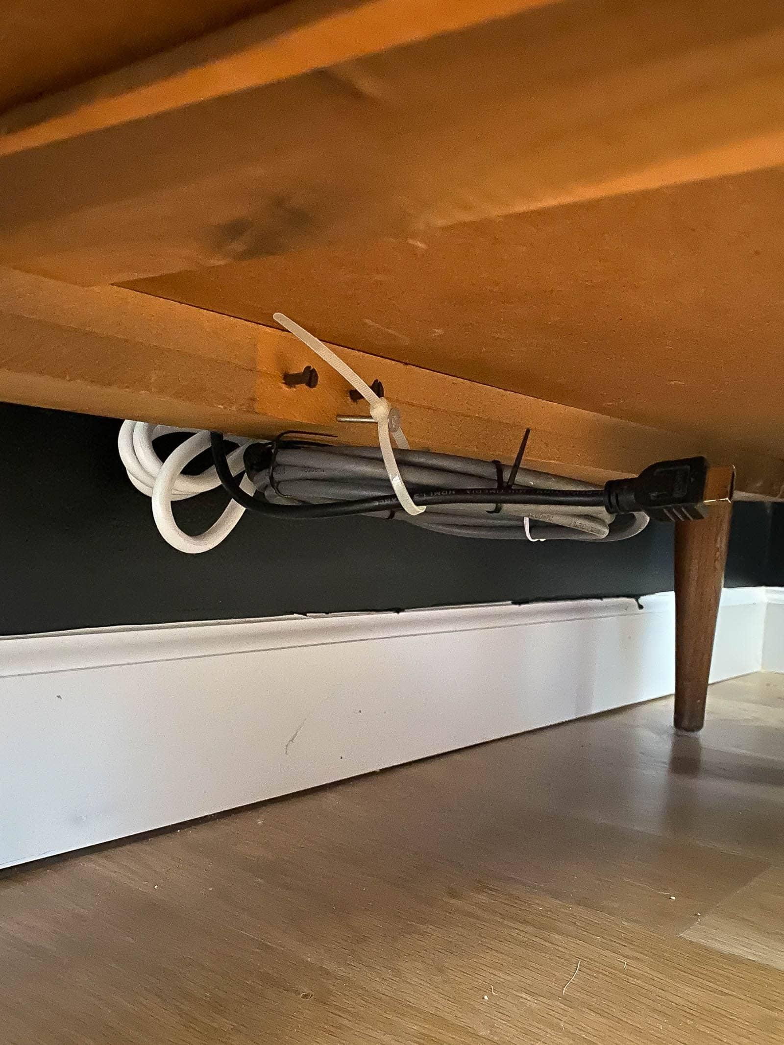 hide cables under furniture