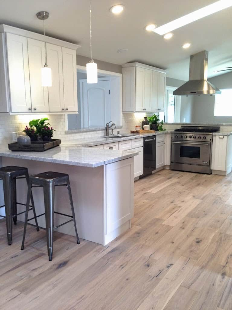 Wood flooring decision bigger than the three of us for Wood flooring kitchen ideas