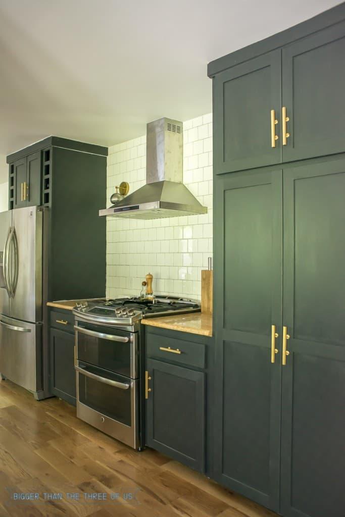 Dark kitchen cabinets with brass pulls