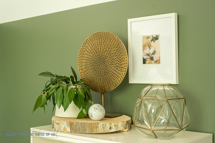 Dresser styling with plants, glass and a frame
