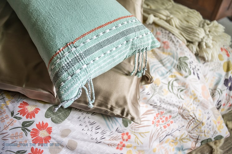 OroseSilk bedding mixed with West Elm pillows and a schoolhouse electric duvet