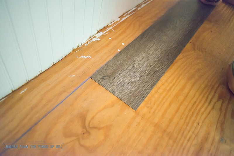 How to install laminate flooring bigger than the three of us for Rubber laminate flooring