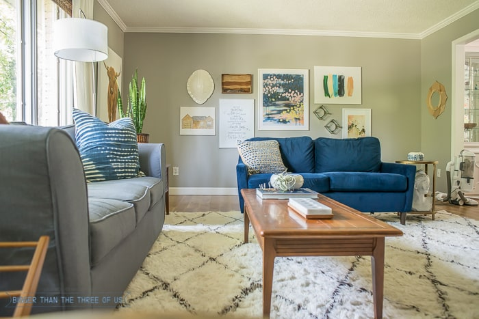 Blue Couch and shag rug with grey walls