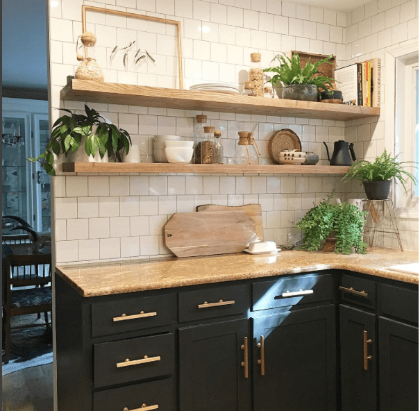 Black Cabinets subway tile and open shelves in kitchen