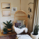 Hanging chair with modern art prints by Becrowbe (On Instagram)