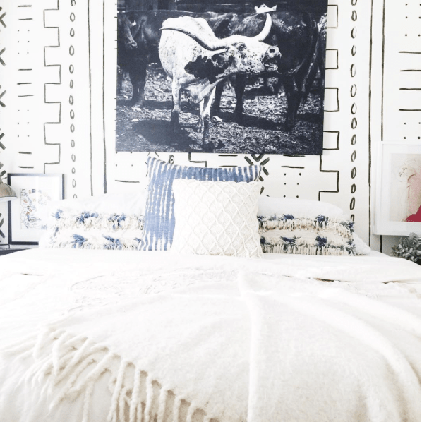 Black and white animal art over bed by Instagrammer @heavythreads