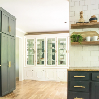 Open shelving with dark cabinets and a china builtin