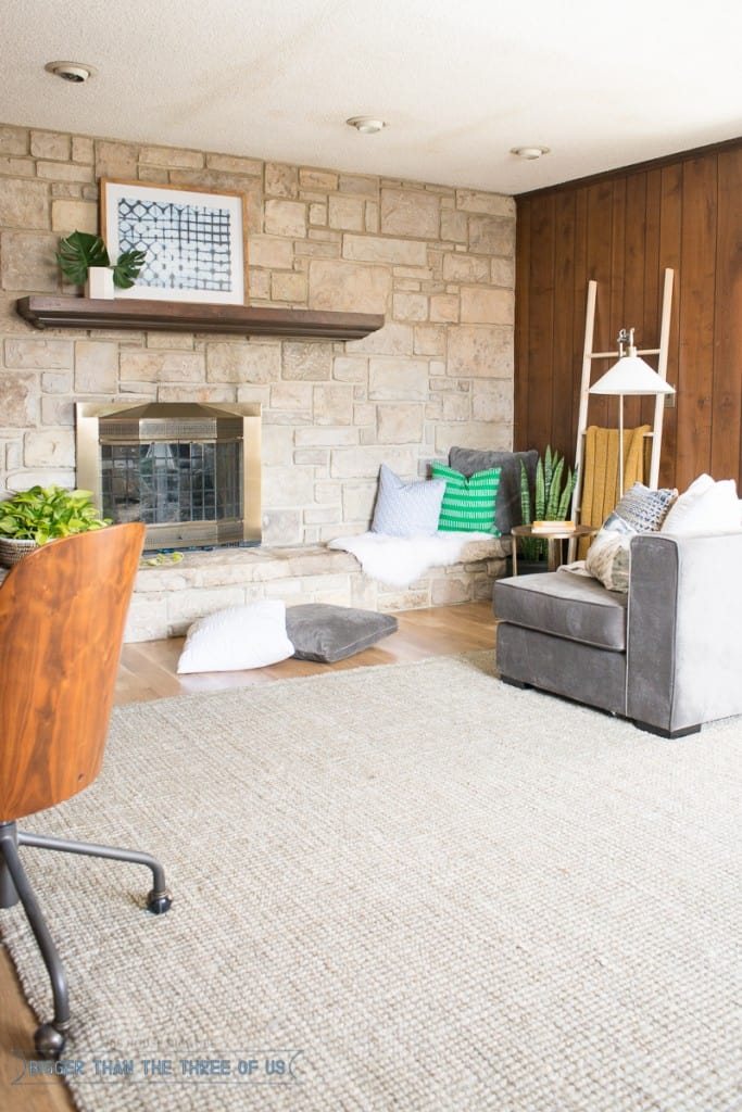 Stacked stone fireplace in playroom