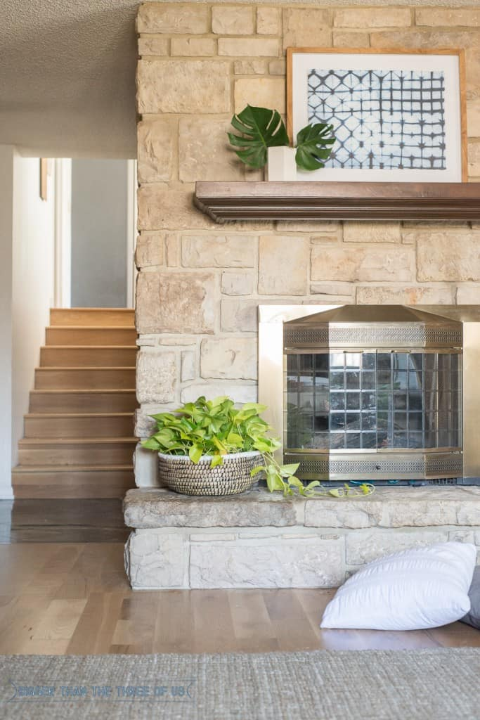 Stacked stone with mantle in playroom