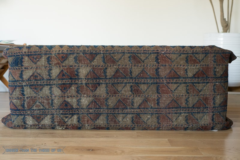 Do you have a boring bench that you want to do something with? How about reupholstering it with a vintage rug? Get the Vintage Rug Upholstered Bench Tutorial right now!