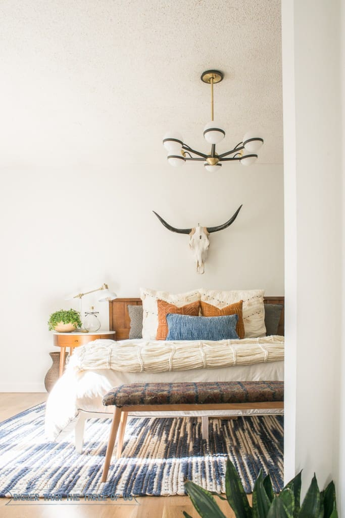 Check out this Mid-Century Bedroom. It has a DIY vintage mid-century bench, and eclectic but minimal touches throughout!