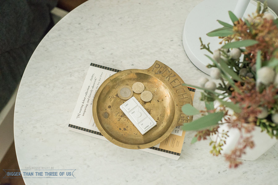 Brass coin tray on nightstand - Nightstand styling idea
